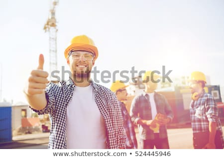 Happy construction worker showing thumbs up Stock photo © elenaphoto