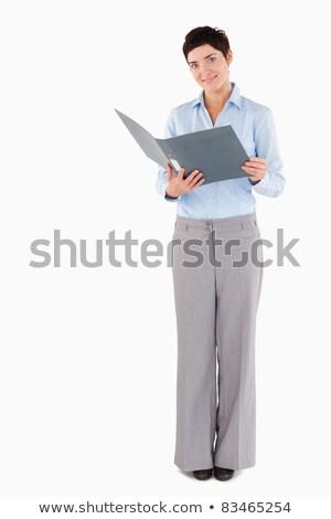 Woman holding a blue binder against white background Stock photo © wavebreak_media