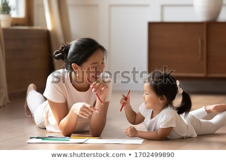 mother and daughter at home mom teachs little girl to draw and stock photo © hasloo