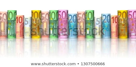 Stock photo: rolled euro bills with coin