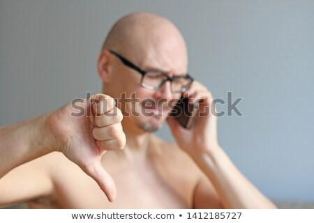 zakenman · tonen · duim · beneden · teleurgesteld - stockfoto © feedough