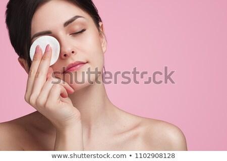 Brunette beauty using lotion. Stock photo © lithian