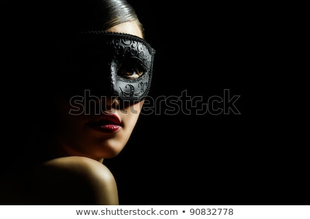 beautiful young woman with mysterious mask stock photo © pxhidalgo