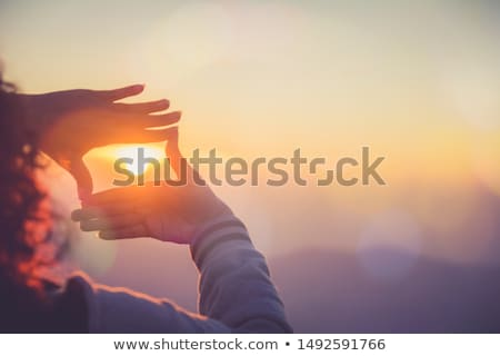 beautiful woman making frame with her hands stock photo © andersonrise