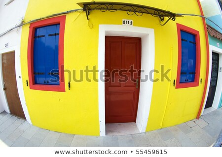 colorful facade of an old fisher house in the village of Burano  Stock photo © meinzahn