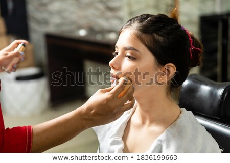pretty girl getting face makeup done stock photo © stockyimages