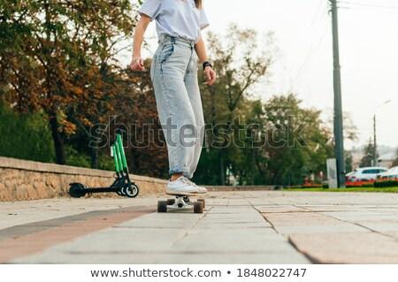 Pretty Woman in Cool Casual Attire with Skateboard Stock photo © dash