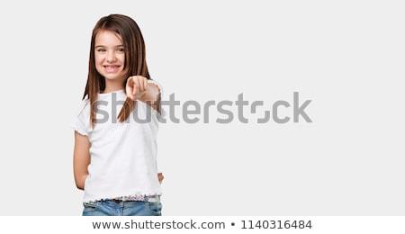 Meisje wijzend jas meisje jeans jonge Stockfoto © JamiRae