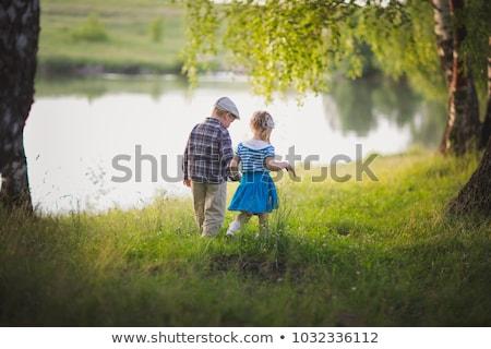 мальчика девушки , держась за руки ходьбе лес женщину Сток-фото © jarin13