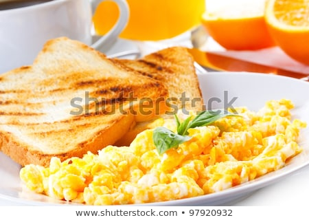 Fresh breakfast food. Scrambled eggs and juice. stock photo © dariazu