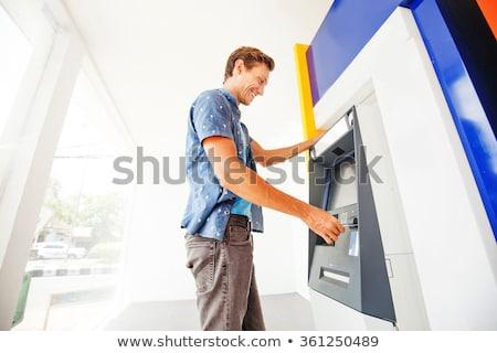 man using banking machine Stock photo © stryjek