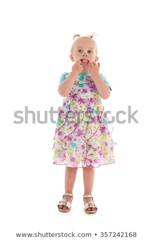 Shy toddler girl in summer dress Stock photo © ivonnewierink