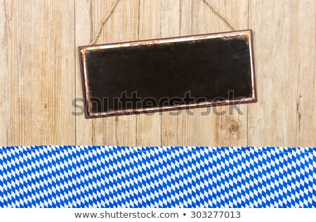 empty metal sign on a wooden wall with bavarian decor stock photo © zerbor