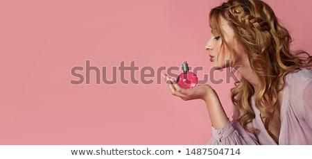 Atrakcyjna kobieta butelki perfum piękna portret Zdjęcia stock © NeonShot