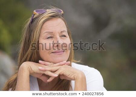 Vonzó nyugodt érett nő szabadtér portré pózol Stock fotó © roboriginal