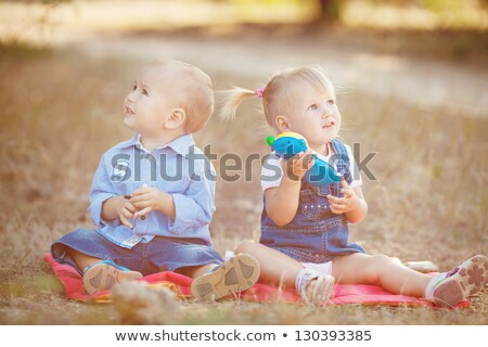 Baby boy and baby girl in the park Stock photo © igabriela