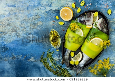 Stock photo: Fish with lemon and olive