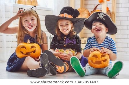 Girl with Halloween pumpkin on black background Stock photo © master1305