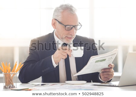 Smiling Senior Businessman with Tea Looking Out Stock photo © ozgur