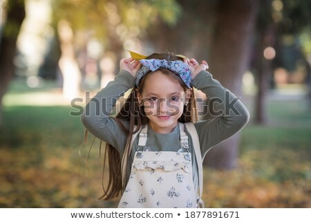 The little girl paints lips in park Stock photo © Paha_L