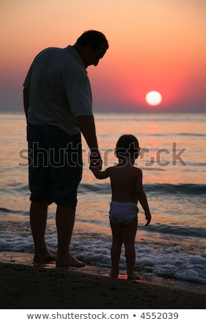 Grandfather with granddaughter on sunset at sea stock photo © Paha_L