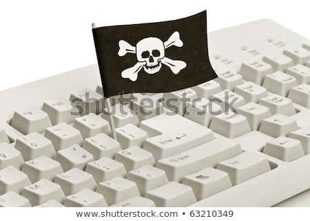 Stock photo: pirate flag and computer keyboard