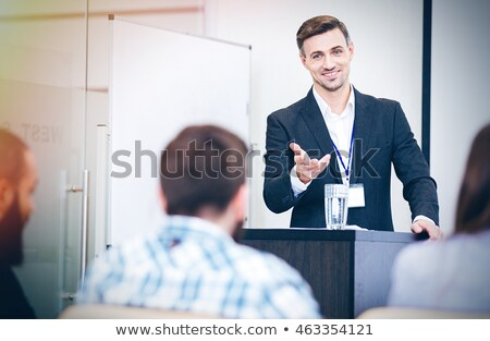 Confident speaker talking to audience on business training  Stock photo © deandrobot