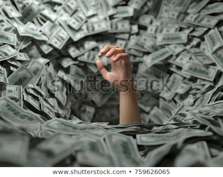 Businessman drowning in money Stock photo © studiostoks