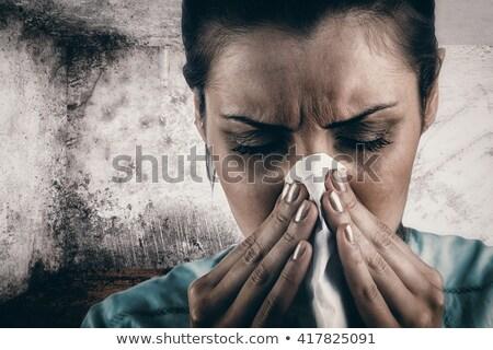 composite image of portrait of woman blowing her nose stock photo © wavebreak_media