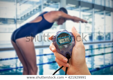 close up on a sportswoman holding a timer stock photo © wavebreak_media