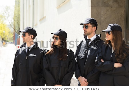 Security Guard Standing In Front Of Gate Stock photo © AndreyPopov
