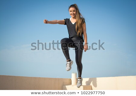 Stockfoto: Young Brunette Falling Down The Sky