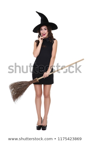 Beautiful young woman in witch costume with hat and broom Stock photo © deandrobot