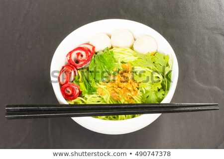 Noodles in Thailand Ba-Mee-Moo-Dang or pasta of Asia on wooden table.Close up and top view. Stock photo © Bigbubblebee99