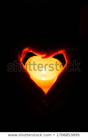 hands with fire in form of heart Stock photo © ssuaphoto