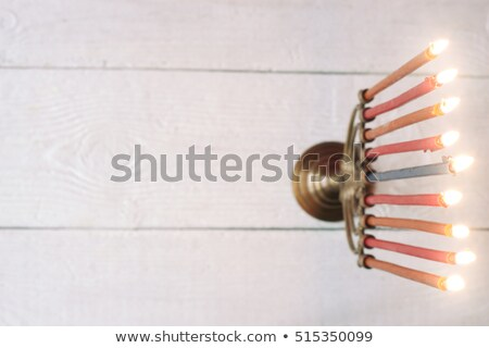 Stock photo: Hanukkah menorah with burning candles on the white wooden table top view