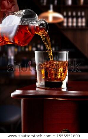 áramló konyak önt üveg fehér buli Stock fotó © PetrMalyshev