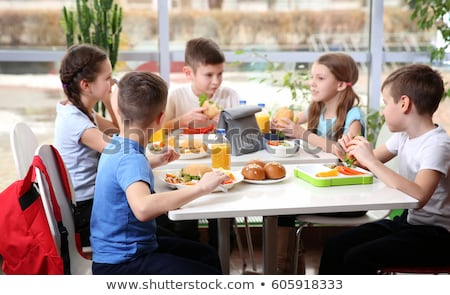 Girl eating at the canteen dining table Stock photo © bluering
