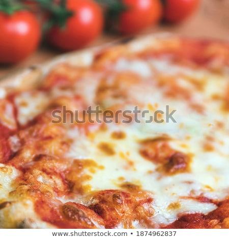 hot fresh delicious pizza margherita dof stock photo © yatsenko