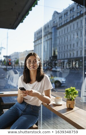 Vertical image of Asian woman near the window Stock photo © deandrobot
