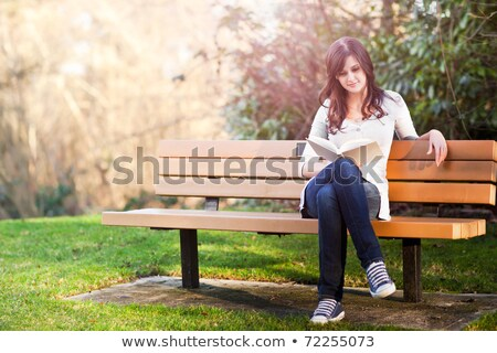 College Student Sitting On Park Bench Stock photo © dtiberio