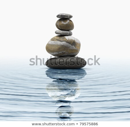 stack of zen rocks with water reflection stock photo © njnightsky