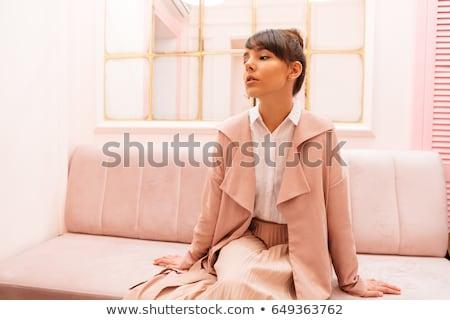 Nadenkend vrouw jas vergadering sofa cafe Stockfoto © deandrobot