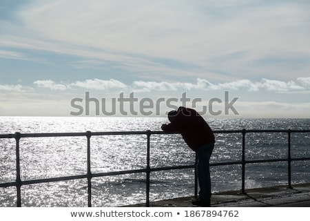 hopeless man looking up to the light stock photo © stevanovicigor