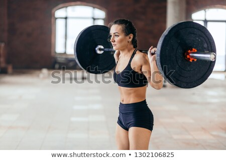 woman doing deadlift in the gym Stock photo © chesterf