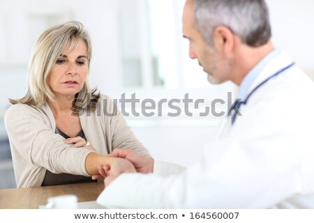 doctor examining a woman wrist stock photo © wavebreak_media