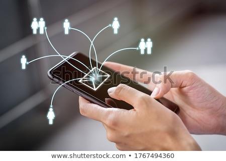 empresário · sms · celular · isolado · branco - foto stock © stevanovicigor