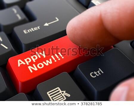 apply now concept person click keyboard button stock photo © tashatuvango