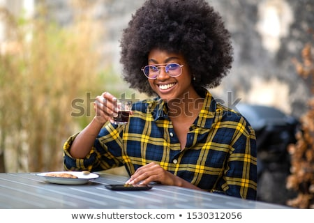 Portrait of a women sitting at a cafe Stock photo © IS2