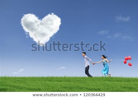 Pár fut léggömbök család férfi energia Stock fotó © IS2